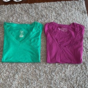 green and pink v-neck tee shirts